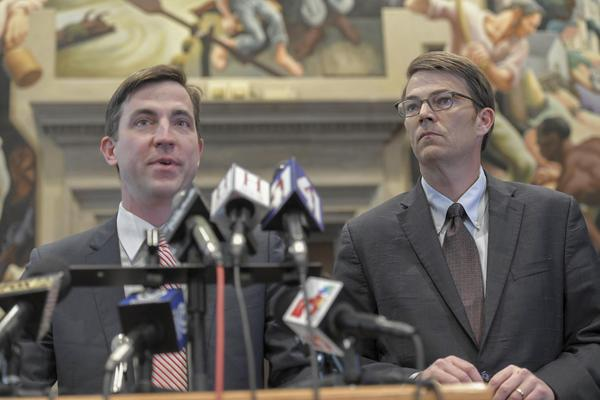 State Rep. Jay Barnes, left, was chairman of a committee that looked into former Gov. Eric Greitens' conduct.