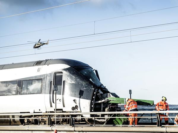 Emergency crews work at the site of a train accident that killed at least six people Wednesday in Nyborg, Denmark. The accident took place on one of the bridges in the Storebaelt system, also known as the Great Belt link.