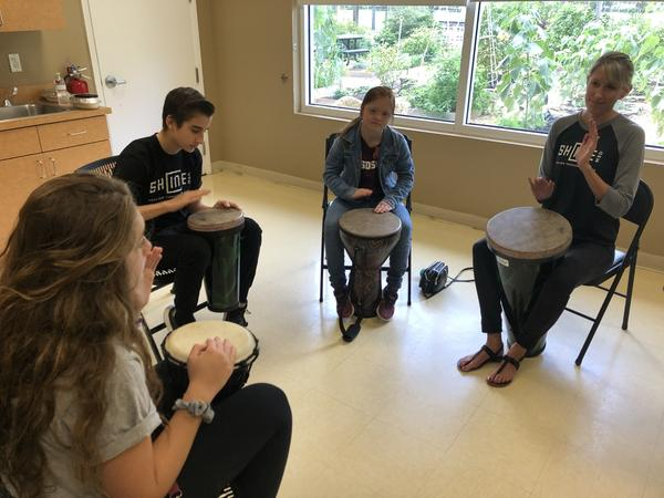 Music therapist Bree Gordon, right, leads Marjory Stoneman Douglas High School students in a drum circle during a free arts therapy workshop in Parkland in late December.