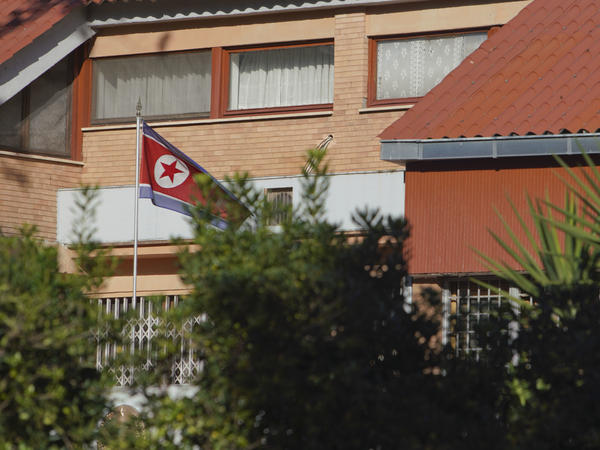 The flag of North Korea waves inside the compound of the North Korean embassy in Rome. North Korea's acting ambassador to Italy, Jo Song Gil, went into hiding with his wife in November, according to South Korea's National Intelligence Service.