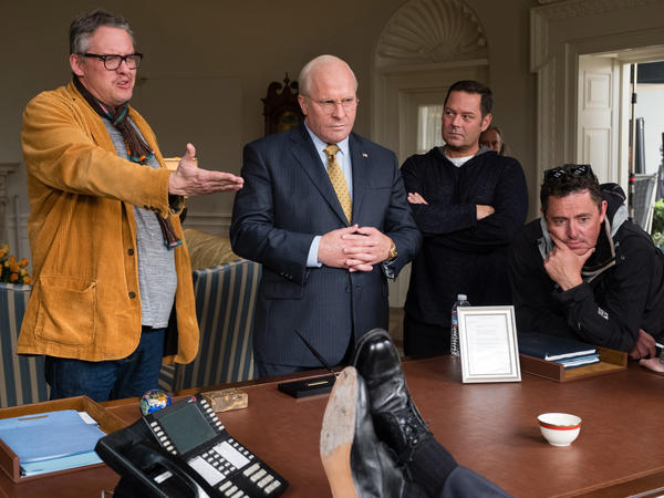 Director Adam McKay (from left), actor Christian Bale, producer Kevin Messick and cinematographer Greig Fraser discuss a scene on the set of <em>Vice</em>.