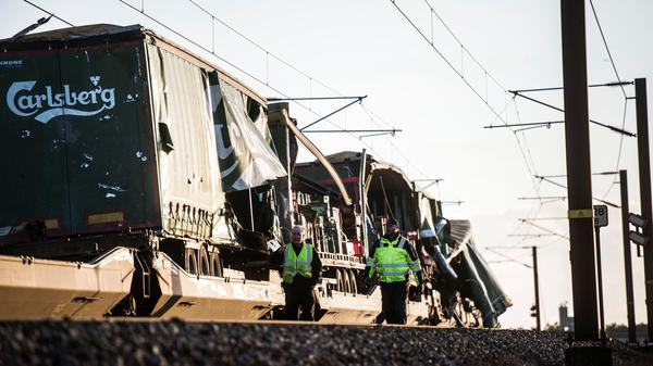Investigators believe part of a freight train caused a fatal passenger train accident in Denmark on Wednesday. Here, the freight train is seen at the scene of the calamity on the Great Belt Bridge.