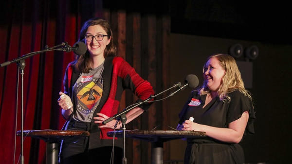 Contestants Lindsay Thompson and Maggie Probst Bussard face off in games on <em>Ask Me Another</em> at the Bell House in Brooklyn, New York.