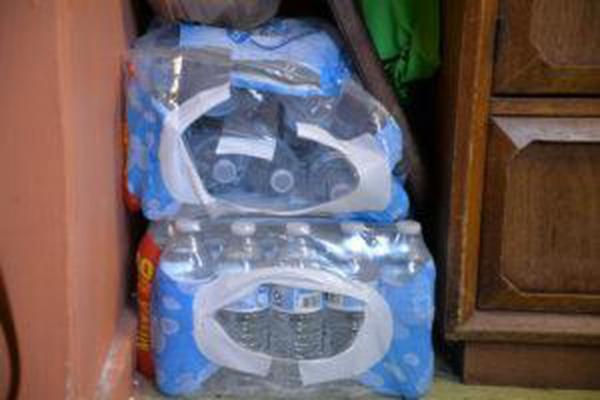 <p>Martin Yanez and Rosalinda Guillen spend about $20 a week buying bottles of water to drink and gallons of water to cook.</p>