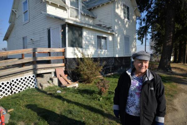 """<p>Rosalinda Guillen lives at her parents' home in Zillah. Since they moved here in 1968, Guillen has noticed a difference in her well water. """"This water stinks,"""" she says.</p>"""