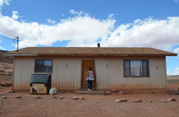 Tara Banally of the Rural Utah Project knocks on a resident's door while doing voter outreach in Monument Valley.