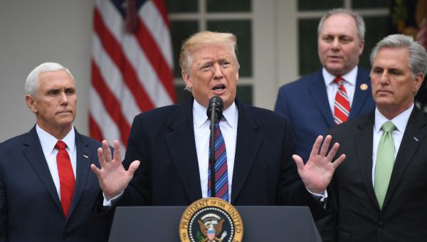 President Trump, with (from left) Vice President Pence, House Minority Whip Steve Scalise and House Minority Leader Kevin McCarthy, addresses reporters in the Rose Garden of the White House about the government shutdown on Friday.