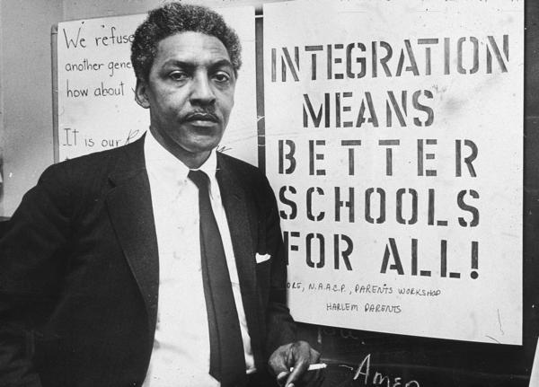 American civil rights activist Bayard Rustin, pictured in 1964, as spokesman for the Citywide Committee for Integration, at the organization's headquarters, Silcam Presbyterian Church in New York City.
