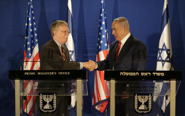 U.S. National Security Advisor John Bolton (left) and Israeli Prime Minister Benjamin Netanyahu shake hands during a joint statement to the media follow their meeting, in Jerusalem on Sunday.