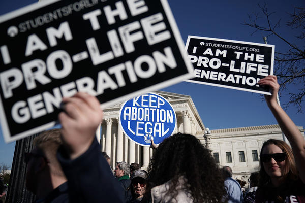 Demonstrators in favor of and against abortion rights made their beliefs known during a January 2018 protest in Washington, D.C.