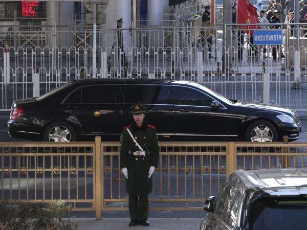 A sedan, believed to carry North Korean leader Kim Jong Un, leaves a train station with a convoy in Beijing. Kim is making a four-day trip to China in what's likely an effort to coordinate with his only major ally ahead of a summit with President Trump that could happen early this year.