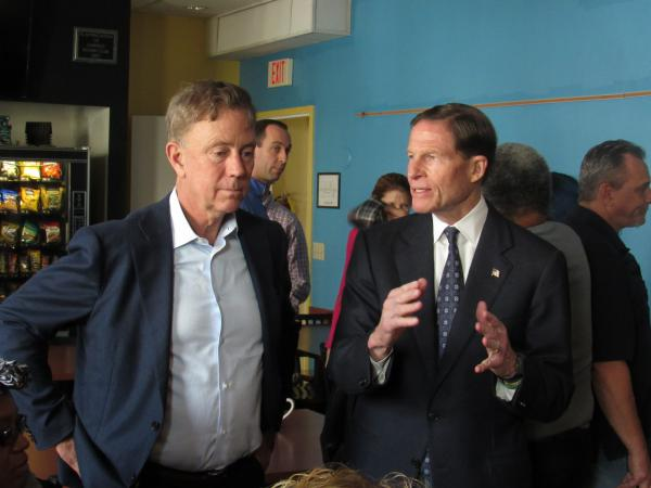 Conn. Gov.-elect Ned Lamont listens to U.S. Sen. Richard Blumenthal as they visit Homes for the Brave, a Bridgeport-based nonprofit providing housing and services for veterans and others in need.