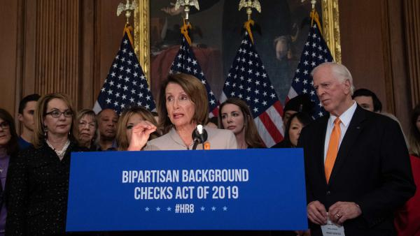 House Speaker Nancy Pelosi, D-Calif., holds a press conference with former Rep. Gabrielle Giffords, left, and Rep. Mike Thompson, D-Calif., to introduce legislation on expanding background checks for gun sales at the Capitol in Washington, D.C., Tuesday.