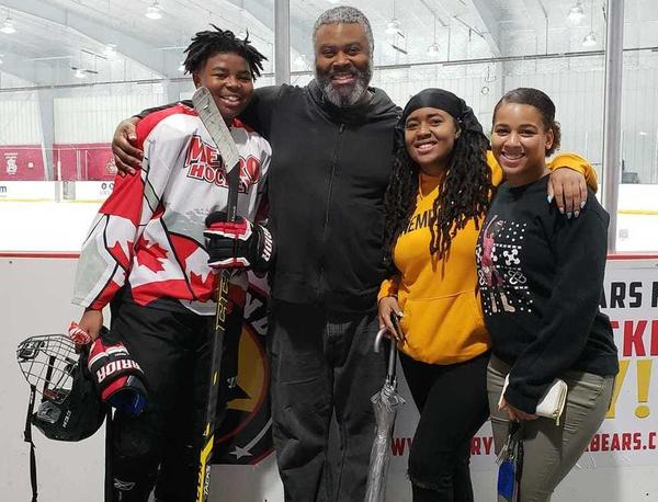 Divyne Apollon II with his father, Divyne Apollon Sr., and his sisters, Deja and Devinity. Divyne, 13, plays defense for the Metro Maple Leafs based in Odenton, Md.