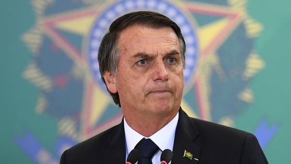 Brazilian President Jair Bolsonaro, pictured on Monday delivering a speech, has withdrawn his country from a United Nations compact on migration.