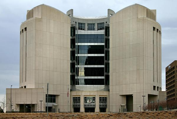 During the now three-week stretch of the partial government shutdown, federal courts such as the U.S. Courthouse in downtown Kansas City, Missouri, have remained open with funding from fees, but that money runs out this Friday.