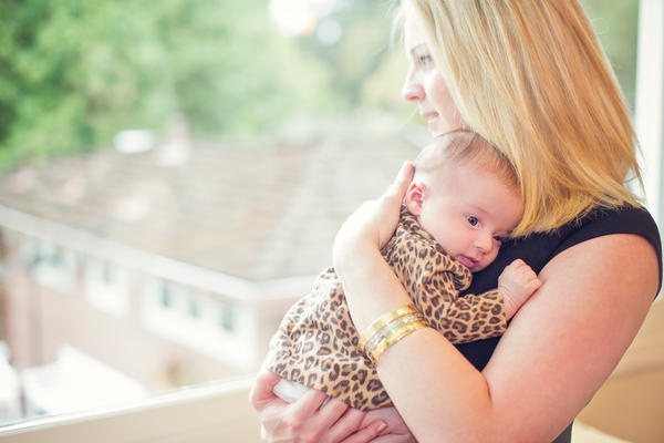 Lisa Abramson holds her firstborn child, Lucy, in 2014. A few weeks after Lucy's birth, Abramson began feeling confused and then started developing delusions — symptoms of postpartum psychosis.