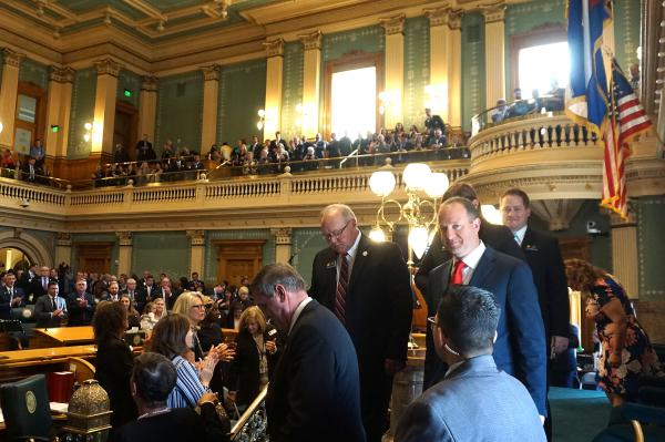 Colorado Gov. Jared Polis leaves the podium after delivering his first State of the State address to lawmakers Thursday morning.