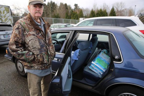 <p>Matt Hall screens baggage for the TSA at the airport. He's been through a furlough before so he has savings to keep his family going for a short while. He picked up some free food and kitty litter from the Oregon Humane Society for his two cats.</p>