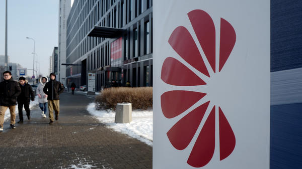 Poland's Internal Security Agency accuses Huawei's sales director in Poland of spying on behalf of China, arresting the Chinese citizen along with one other man. Here, people walk by Huawei's offices in Warsaw on Friday.