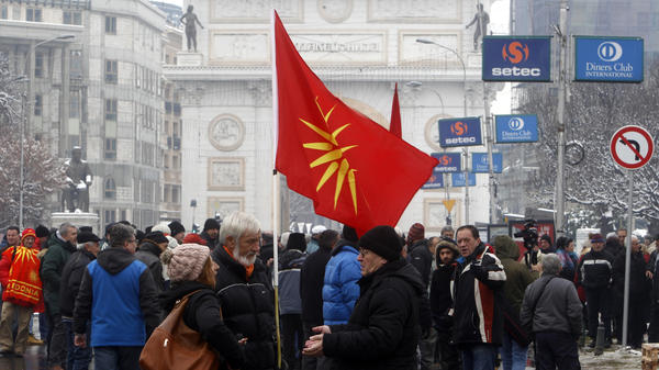 People gather outside the parliament building in Macedonia to protest the country's name change to North Macedonia.