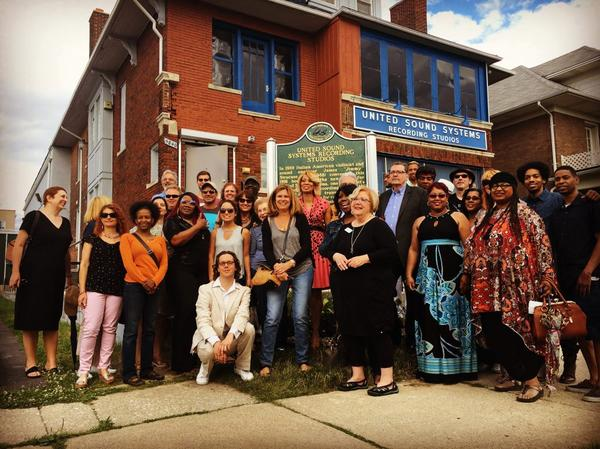 Advocates and members of Detroit Sound Conservancy stand in front of a state historic marker posted in front of United Sound Systems in 2017.