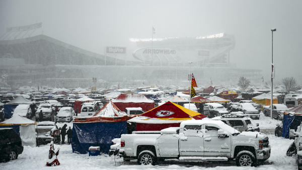 Snow falls on Saturday in Kansas City before a game between the Chiefs and the Indianapolis Colts at Arrowhead Stadium. More than a foot of snow fell in some regions of the Midwest.