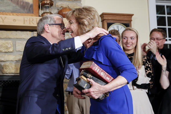 Gov. Mike DeWine hugs First Lady Fran DeWine after being sworn in as governor.