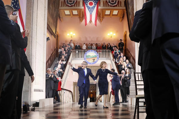 Ohio Gov. Mike DeWine and First Lady Fran DeWine greet supporters as they walk into the Statehouse Rotunda for the Inauguration Ceremony.