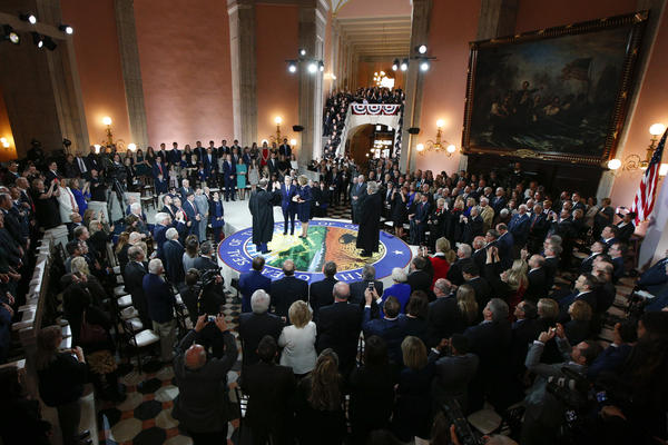 Supporters watch Gov. Mike DeWine take the oath of office.