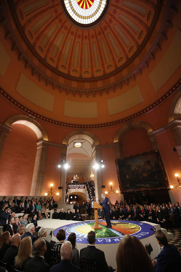 A packed Statehouse Rotunda watch Gov. Mike DeWine deliver his inauguration address.