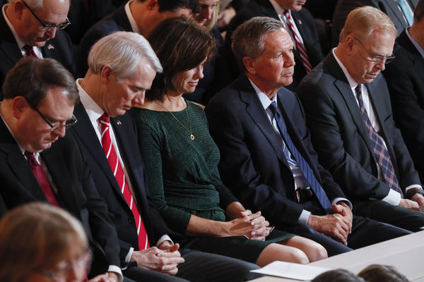 Former Ohio Governors John Kasich (R) and Ted Strickland (D) attend Gov. Mike DeWine's inauguration ceremony.