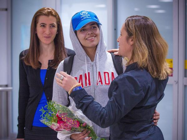 Rahaf Mohammed Alqunun (center) is welcomed by Canadian Minister for Foreign Affairs Chrystia Freeland as she arrives at Pearson International Airport in Toronto, Ontario, on Saturday. The young Saudi woman who fled her family successfully harnessed the power of Twitter to secure asylum in Canada.