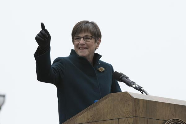 Newly sworn-in Kansas Gov. Laura Kelly gave an inaugural address calling on Kansas to leave behind partisanship and return to a sense of cooperation.