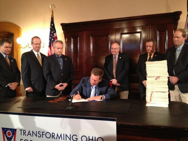 Gov. John Kasich signs his budget - which included abortion restrictions - in a photo that went viral in 2013.