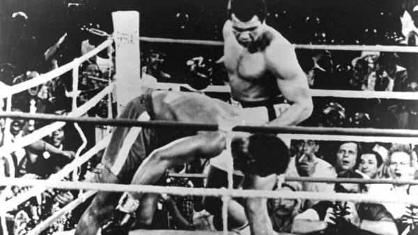 """Muhammad Ali lands a left hook knocking out George Foreman during the """"Rumble in the Jungle"""" fight in 1974. After the match, Ali gave a shout-out to his hometown of Louisville, Ky."""