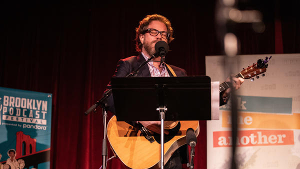 <em>Ask Me Another</em>'s house musician Jonathan Coulton leads a music parody game at the Bell House in Brooklyn, New York.
