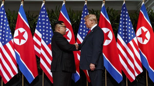 North Korean leader Kim Jong Un and President Trump shake hands prior to their meeting in Singapore in June 2018.