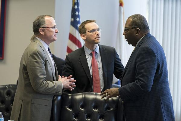 Commission member Todd Williams of Dallas, left, meets with TEA Commissioner Mike Morath and state Sen. Royce West at the Texas Commission on Public School Finance on Jan. 23, 2018.