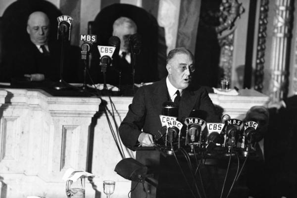 """President Franklin D. Roosevelt adresses a joint session of Congress as Speaker Sam Rayburn, left, and Vice President John N. Garner, look on. With World War II looming, Roosevelt used his 1941 address to outline the """"four freedoms,"""" freedom of speech, freedom of worship, freedom from want and freedom from fear."""