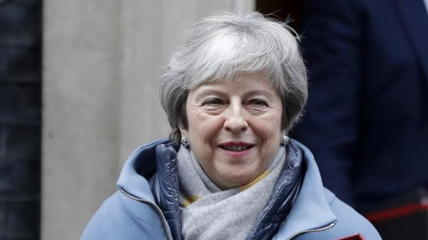 Prime Minister Theresa May leaves Downing Street on Monday to attend parliament.
