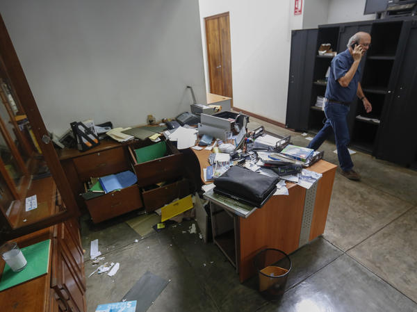 """Carlos Fernando Chamorro, editor of <em>Confidencial, </em>walks through the publication's ransacked offices in Managua, Nicaragua, in December, 2018. Chamorro has fled the country, citing """"threats"""" from the government."""