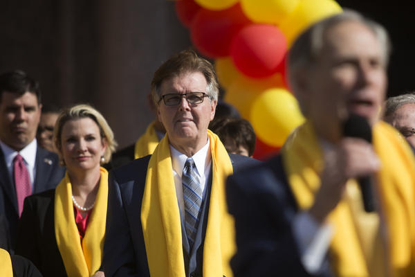 Lt. Gov. Dan Patrick looks on as Gov. Greg Abbott addresses the National School Choice Week rally in 2017.