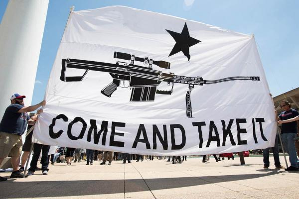 Gun rights advocates attend an open carry firearm rally at Dallas City Hall during the National Rifle Association's 147th Annual Meeting.