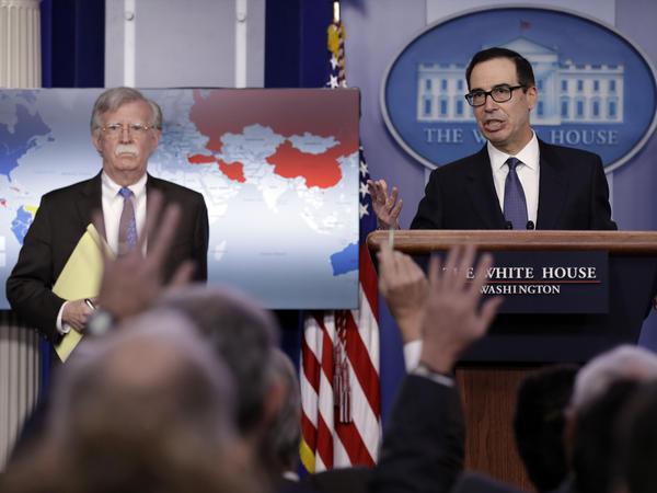 Treasury Secretary Steven Mnuchin (right) and National Security Adviser John Bolton announce sanctions against Venezuela, which are meant to put pressure on Venezuelan President Nicolás Maduro.