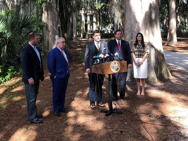On Jan. 17, Matt Goetz (middle) introduces John Morgan (on left) during a press conference announcing changes to the handling of the smoking ban on medical marijuana. Gov. Ron DeSantis (on right) said he would like to see lawmakers make changes.