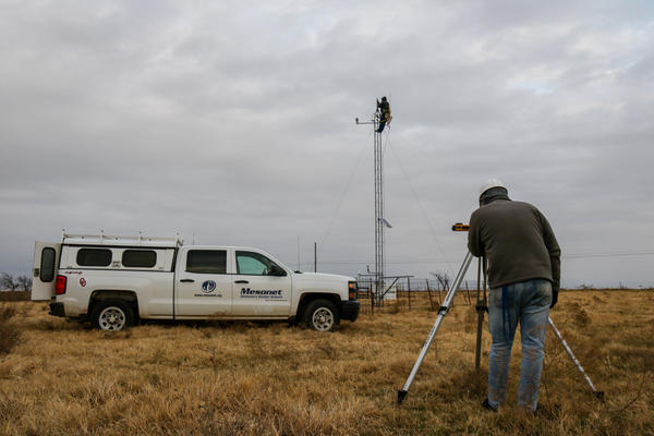 Meteorological Electronics Technicians Christopher Bieschke and Kirk Wilson replace a wind sensor atop a 30-foot tower at an Oklahoma Mesonet station near Shawnee, Okla.