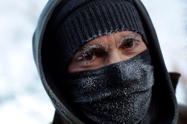 Frank Lettiere's eyebrows and eyelashes froze after his walk along Lake Michigan's Chicago shoreline Wednesday. Frostbite warnings were issued for parts of the U.S. Midwest as temperatures plunged.