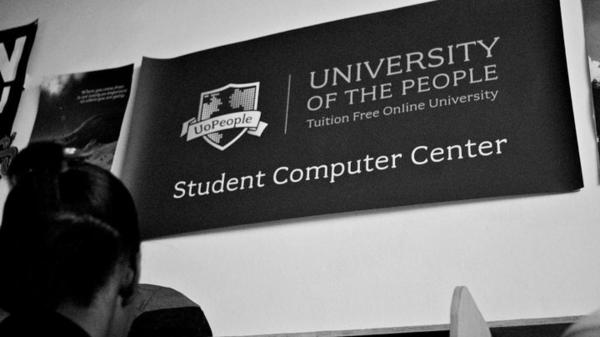 Students work at the University of the People student computer center in Haiti. Students from 129 countries are currently enrolled with the institution.