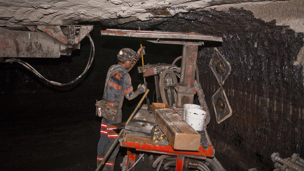 A roof bolter secures the roof of a newly mined section of a coal mine. Studies show roof bolters sometimes have high exposure to the silica dust that is especially toxic to lungs.